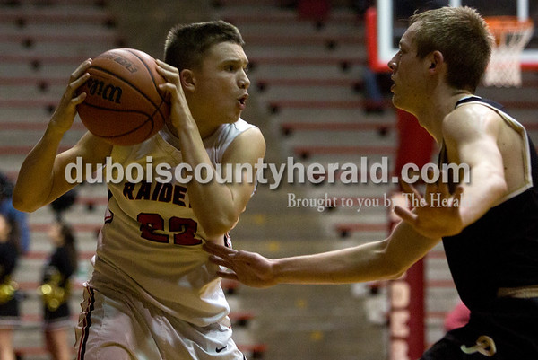 Southridge's Braden Harding looked to pass the ball during Friday night's game against Boonville at Memorial Gym in Huntingburg. Southridge defeated Boonville 56-54. Tegan Johnston/The Herald