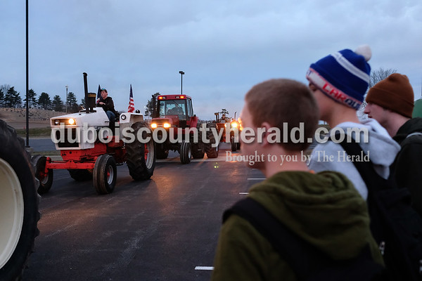 A parade of 10 tractors arrived at the same time Tuesday morning in the school's parking lot during Drive Your Tractor To School Day. Dave Weatherwax/The Herald