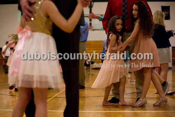 Tegan Johnston/The Herald Chad Kempf of Jasper danced with his daughters Giana, 7, left, and Amia, 11, during the second annual Daddy and Daughter Dance on Saturday evening at Jasper Middle School in Jasper.  Dance Central Academy Parent Club sponsored the event that drew over 300 people.