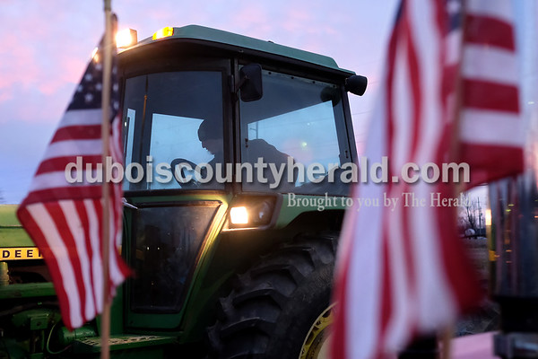 Southridge High School junior Justin Lammers parked his tractor Tuesday morning in the school's parking lot during Drive Your Tractor To School Day. Dave Weatherwax/The Herald