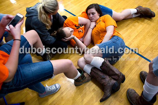 """Tegan Johnston/The Herald Northeast Dubois freshman MaKena Everman, right, laid on top of freshman Fantasy Wright after lunch Thursday. The school dressed to remember their classmate Chad Knies who passed in a car accident Sunday. The students wore orange shirts that match the color of his favorite tractor, cut-off jean shorts and high, white socks with boots or black tennis shoes which the students said he would always wear. """"He was just a really outgoing person,"""" Everman said. """"Being such a small school...when you take one of us out, it takes us all out. We were all affected by what happened because he was so close to most people."""""""
