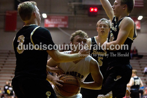 Southridge's Logan Seger made his way to the basket to take a shot during Friday night's game against Boonville at Memorial Gym in Huntingburg. Southridge defeated Boonville 56-54. Tegan Johnston/The Herald