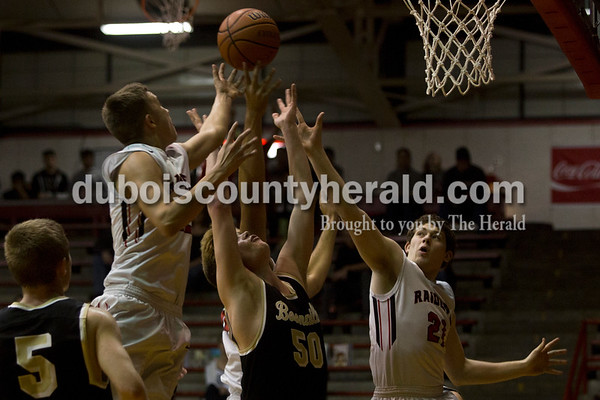 Southridge's Braden Harding, left, and Jayce Harter reached for the ball off the rebound during Friday night's game against Boonville at Memorial Gym in Huntingburg. Southridge defeated Boonville 56-54. Tegan Johnston/The Herald