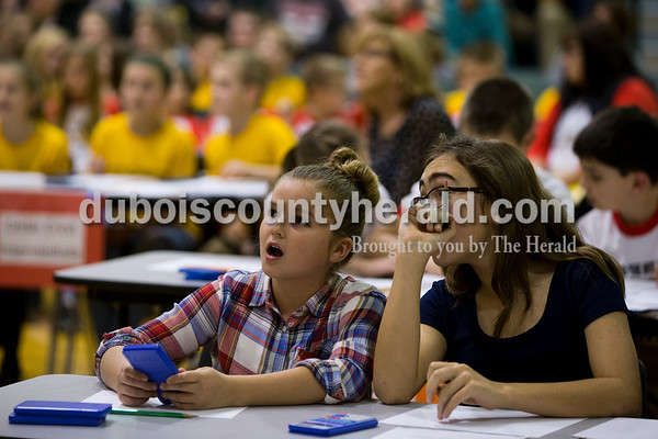 Ireland Elementary fourth-grader CC Hanneman, left, and fifth-grader Emma Schipp discussed an equation during the 21st Annual Indiana Academic M.A.T.H. Bowl at Cedar Crest Intermediate School on Thursday. Ireland Elementary placed first in their division.   Alisha Jucevic/The Herald