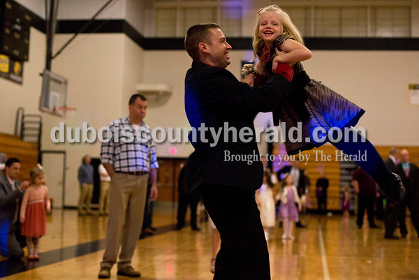 Tegan Johnston/The Herald Kevin Powell of Jasper twirled his daughter Callie, 6, around while dancing with her during the second annual Daddy and Daughter Dance on Saturday evening at Jasper Middle School in Jasper.  Dance Central Academy Parent Club sponsored the event that drew over 300 people.