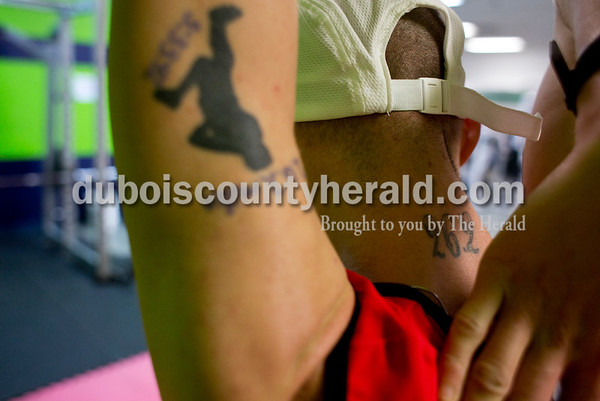 Tegan Johnston/The Herald Donald Schepers of Celestine stretched at B&B Fitness after a 4.3 mile run Tuesday morning in Jasper. Schepers is in his first month of training for his third marathon run in Nashville.