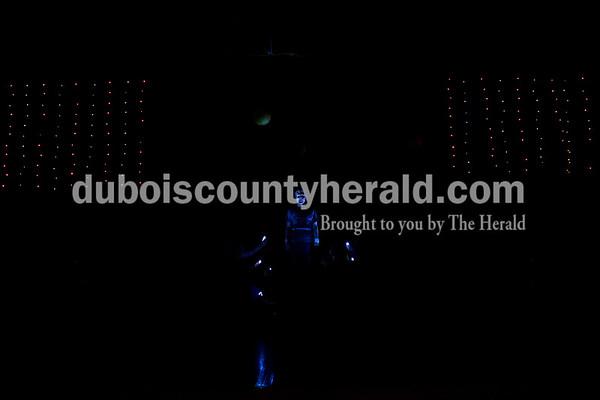 "Southridge High School senior Kru Allen was illuminated by flashlights during a ""Godspell"" rehearsal at the school in Huntingburg on Tuesday. Sarah Ann Jump/The Herald"