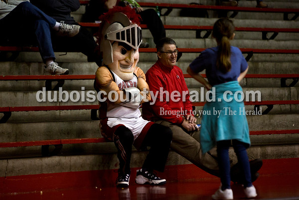 Ellie Bardwell of Huntingburg, 10, talked to her father, Brett, and the Southridge mascot during Friday night's game against Boonville at Memorial Gym in Huntingburg. Southridge defeated Boonville 56-54. Tegan Johnston/The Herald