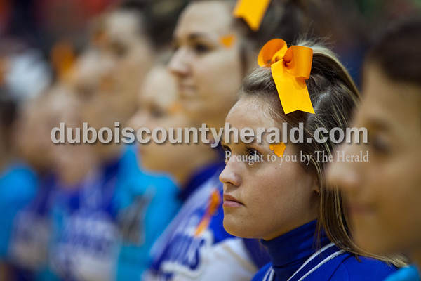 Northeast Dubois cheerleader La'Kiegha Fawks looked toward the flag as the gymnasium took a moment of silence to remember Northeast Dubois student Chad Knies, who died recently in a car accident, before Friday night's game in Ferdinand.   Alisha Jucevic/The Herald