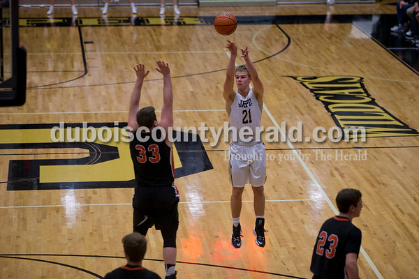 Jasper's Andrew Schmitt released a 3-pointer during Tuesday night's game against North Daviess in Jasper. The Wildcats won 60-48.   Alisha Jucevic/The Herald