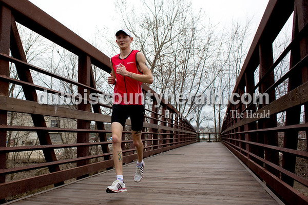 Tegan Johnston/The Herald Donald Schepers of Celestine ran along the river walk while training Tuesday morning during a 4.3 mile run in Jasper. Schepers is in his first month of training for his third marathon run in Nashville.