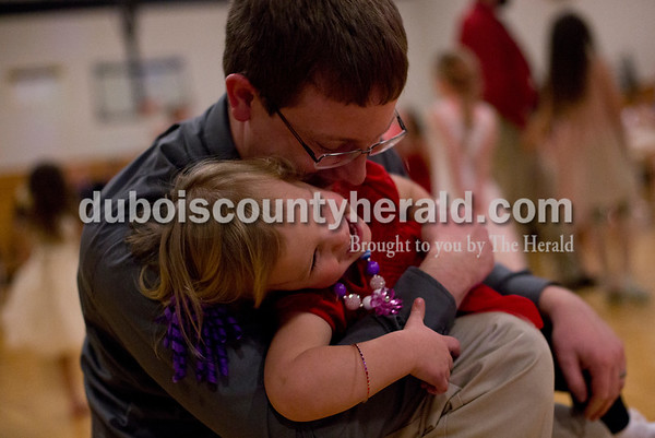 Tegan Johnston/The Herald Clint Buechlein of Jasper kissed his daughter Kaydence, 2, during the second annual Daddy and Daughter Dance on Saturday evening at Jasper Middle School in Jasper.  Dance Central Academy Parent Club sponsored the event that drew over 300 people.