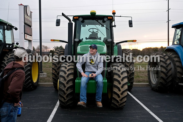 Southridge High School senior Prestyn Balsmeyer  sat on the front of his tractor Tuesday morning in the school's parking lot during Drive Your Tractor To School Day. Dave Weatherwax/The Herald