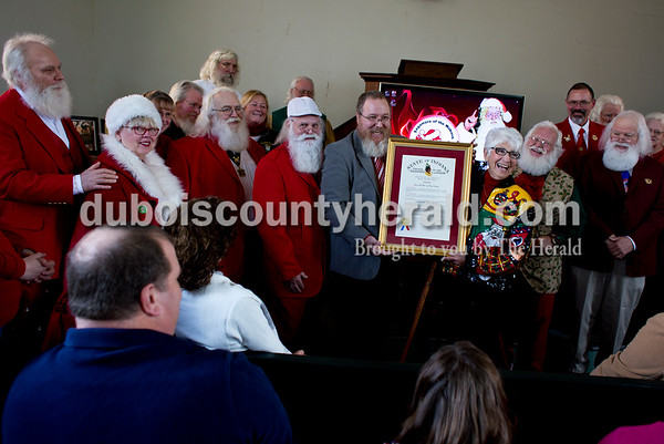 """Tegan Johnston/The Herald Timothy Etter of Fishers, center left, presented Pat Koch with the Sagamore of the Wabash award on behalf of her late father Raymond Joseph """"Jim"""" Yellig Saturday in Santa Claus. The award is Indiana's highest civilian award given to a Hoosier by the governor for a great service to the state or to the governor. Yellig was honored for his service as Santa Claus by responding to children's letters, spreading the Christmas joy and preserving the faith of children."""