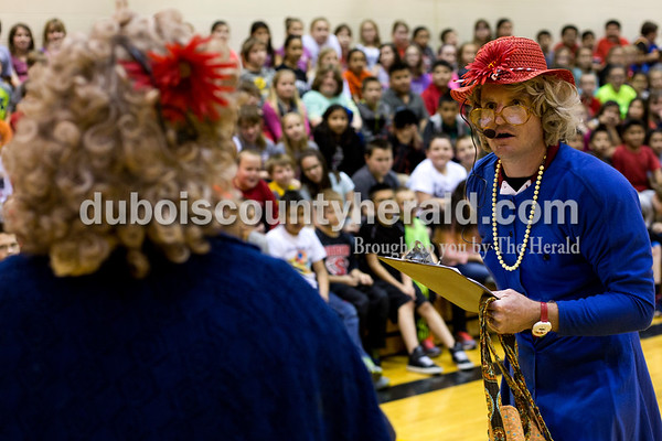 Tegan Johnston/The Herald Huntingburg Elementary School principal Chad Whitehead, right, and fourth-grade teacher Jennifer Underhill offered testing taking tips to the students during an ISTEP rally on Friday afternoon in Huntingburg. Whitehead and Underhill dressed up to perform a skit to help the students relax and prepare for state testing which begins next week.