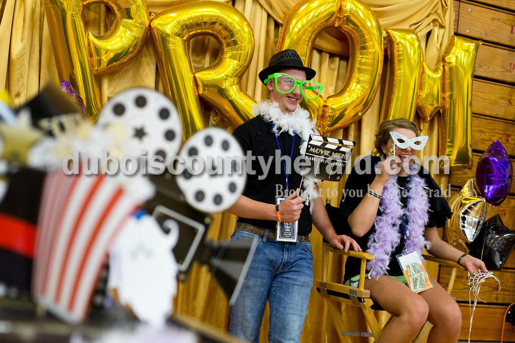 Tegan Johnston/The Herald<br /> Northeast Dubois senior Bailey Hopf and her date Forest Park alumna Chance Hasenour posed for pictures together in the photo booth during the school's post-prom party on Saturday evening. Juniors and seniors gathered with their guests in the high school gym to enjoy the Hollywood-themed event's variety of games and refreshments.