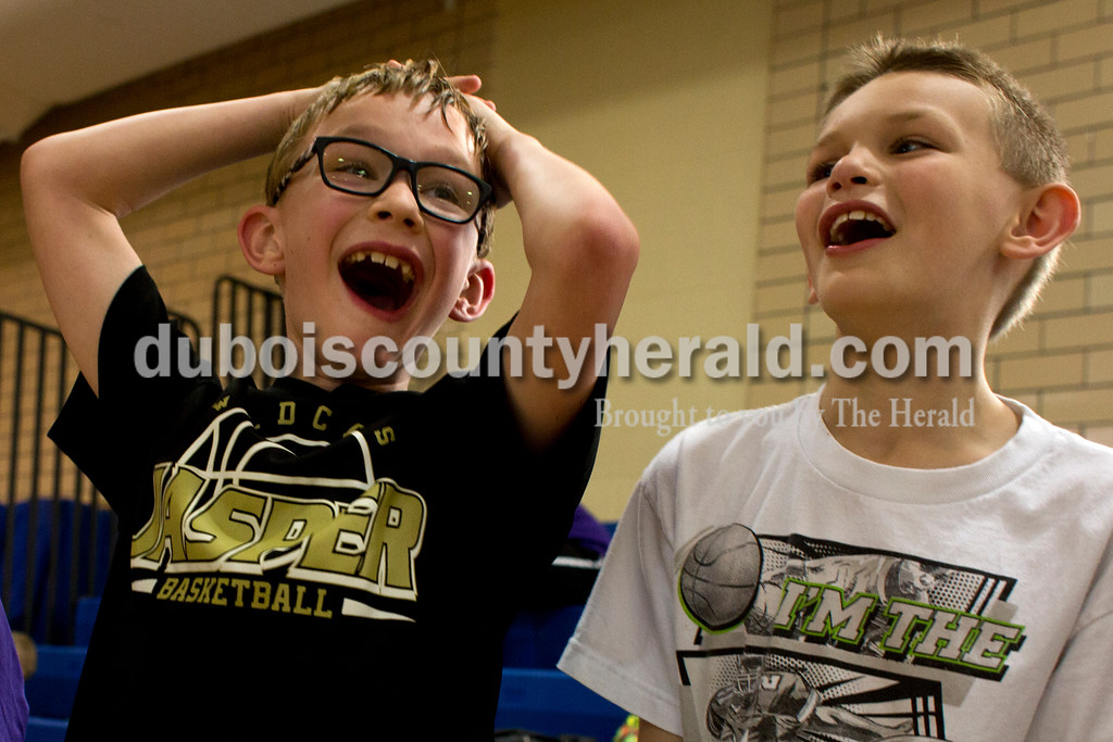 Tegan Johnston/The Herald<br /> Holy Trinity second-graders Grant Wehr, left, and Sawyer Reckelhoff cheered for their classmate during Holy Trinity Family Dodge Ball Night at Holy Family's East Campus Gymnasium in Jasper on Friday night. The school hopes to start having monthly dodge ball games where students can play together and get to know their classmates. From 6-7:30 p.m. second through fourth grade students can play with their parents, and from 7:30-9 p.m. fifth through eighth grade students can compete.