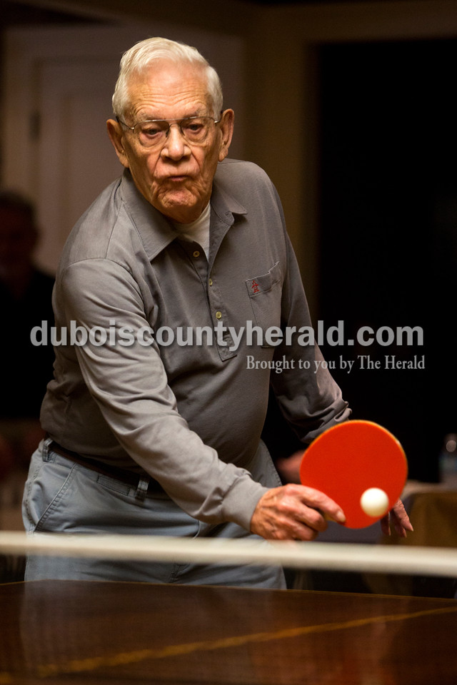 Tegan Johnston/The Herald<br /> Jim Fritch of Jasper, 88, returned the ball while competing a ping pong tournament Saturday at the home of his son, Dan Fritch, in Jasper. Jim is the oldest member of a group that competes regularly in table tennis on Saturday afternoons throughout the winter months.