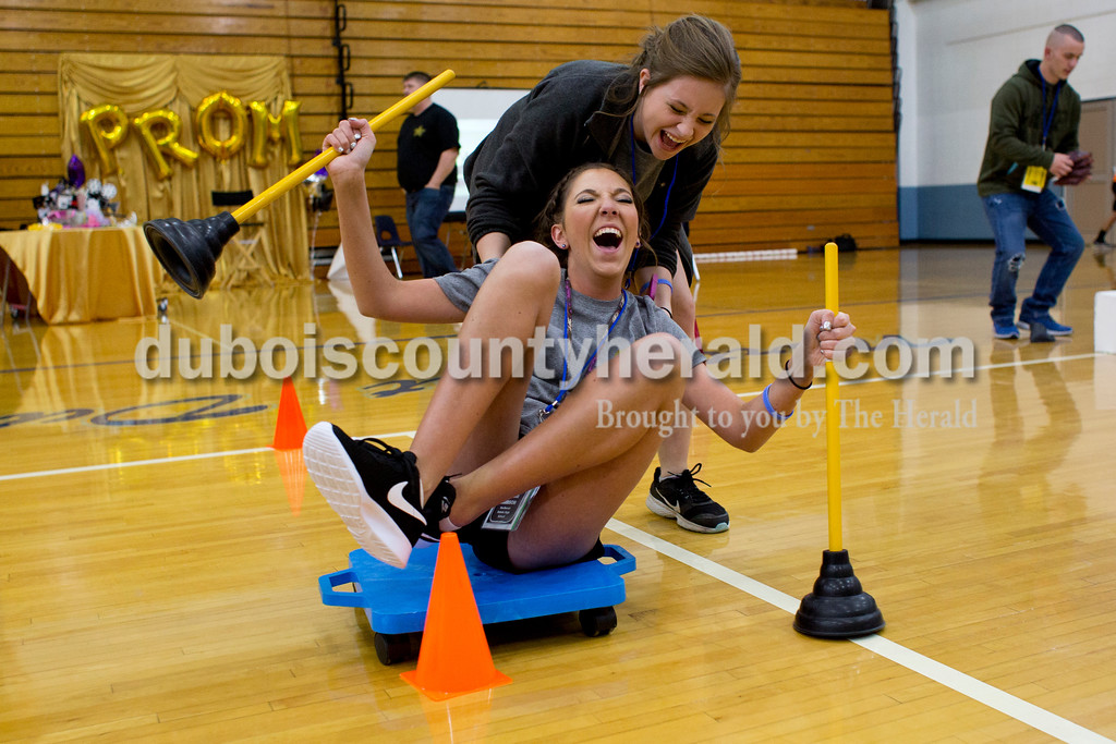 Tegan Johnston/The Herald<br /> Northeast Dubois juniors Kennedie Knies pushed Mykenzie Harrison through an obstacle course during the school's post-prom party on Saturday evening. Juniors and seniors gathered with their guests in the high school gym to enjoy the Hollywood-themed event's variety of games and refreshments.