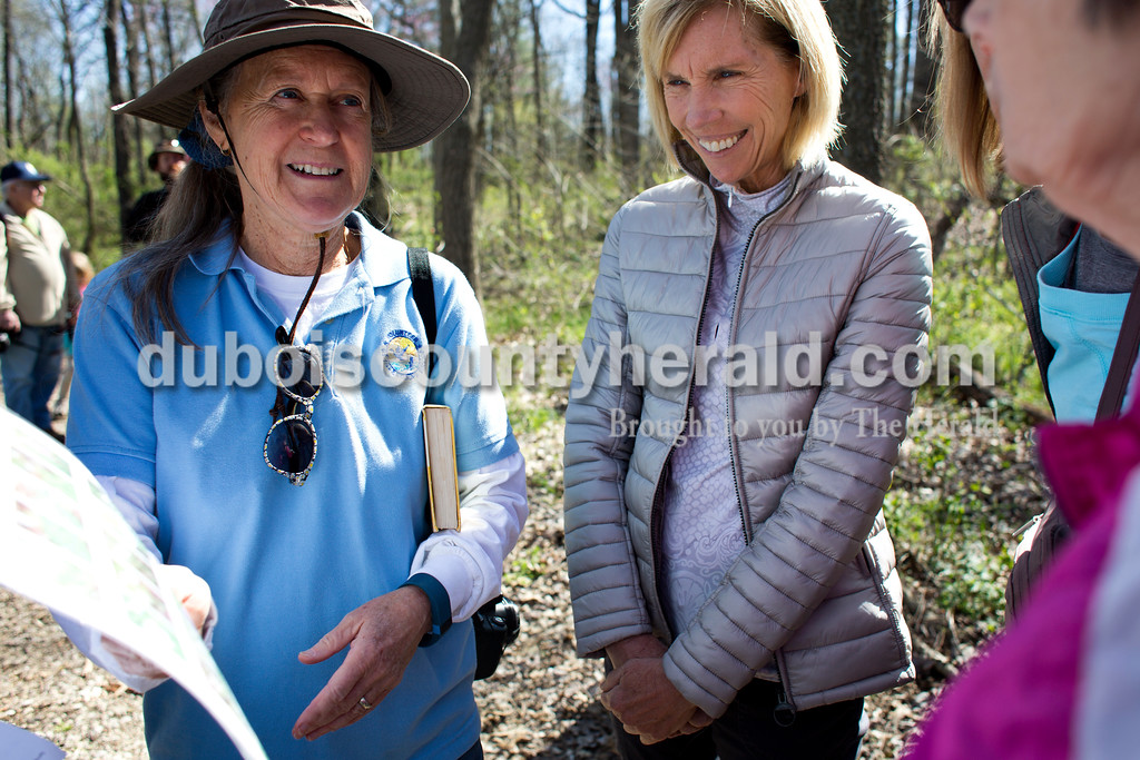 Tegan Johnston/The Herald<br /> Patoka River National Wildlife Refuge Friends president Nancy Gehlhausen of Oakland City showed a chart with a variety of plants and wildflowers to Robin Norris of Jasper, center, and Carol Griesemer of Princeton during a nature walk on Saturday at the Patoka River National Wildlife Refuge. Patoka River National Wildlife Refuge Friends sponsored a spring wildflower walk and photography workshop to promote support and awareness for the refuge.