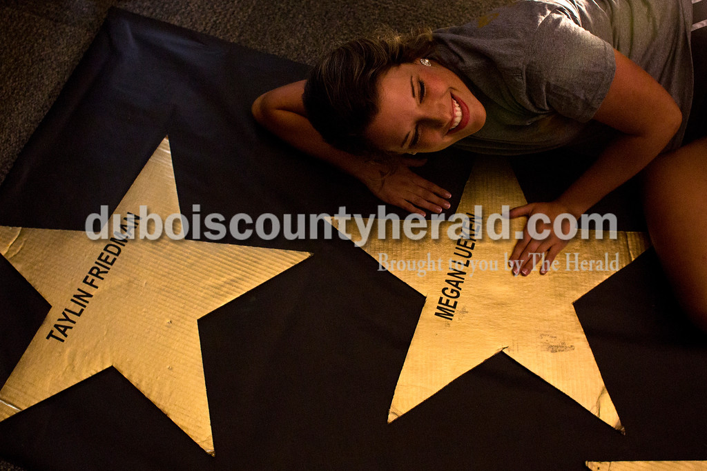 """Tegan Johnston/The Herald<br /> Northeast Dubois senior Megan Lueken posed next to her star on """"The Walk of Fame"""" during the school's post-prom party on Saturday evening. Juniors and seniors gathered with their guests in the high school gym to enjoy the Hollywood-themed event's variety of games and refreshments."""