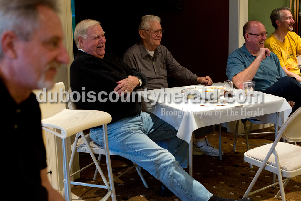 Tegan Johnston/The Herald<br /> Gary Metzgar of Huntingburg, from left, John Habig, Jim Fritch, Paul Grammer and Chuck Renner, all of Jasper, enjoyed snacks while watching a round of doubles during a ping pong tournament Saturday at Dan Fritch's home in Jasper. On Saturday afternoons throughout the winter months, a group of 8-18 men will gather at each other's homes, ante up $1 and randomly pair off to compete in matches of doubles.