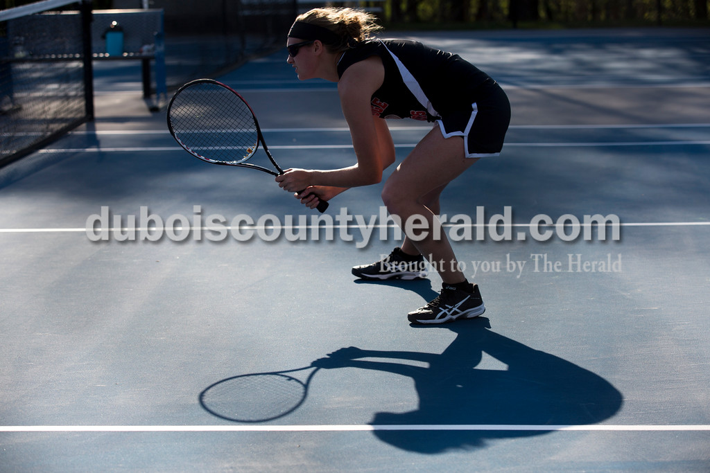 Southridge's Leah Diekhoff crouched as her doubles partner Mackenzie Lubbehusen served during Monday's tennis match in Dubois. Southridge defeated Northeast Dubois 3-2. Sarah Ann Jump/The Herald