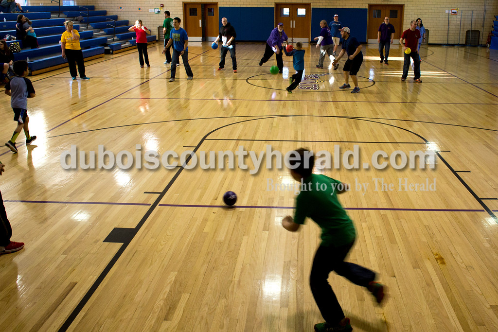 Tegan Johnston/The Herald<br /> Holy Trinity second through fourth graders took on their parents in a round of dodge ball during Holy Trinity Family Dodge Ball Night at Holy Family's East Campus Gymnasium in Jasper on Friday night. The school hopes to start having monthly dodge ball games where students can play together and get to know their classmates. From 6-7:30 p.m. second through fourth grade students can play with their parents, and from 7:30-9 p.m. fifth through eighth grade students can compete.