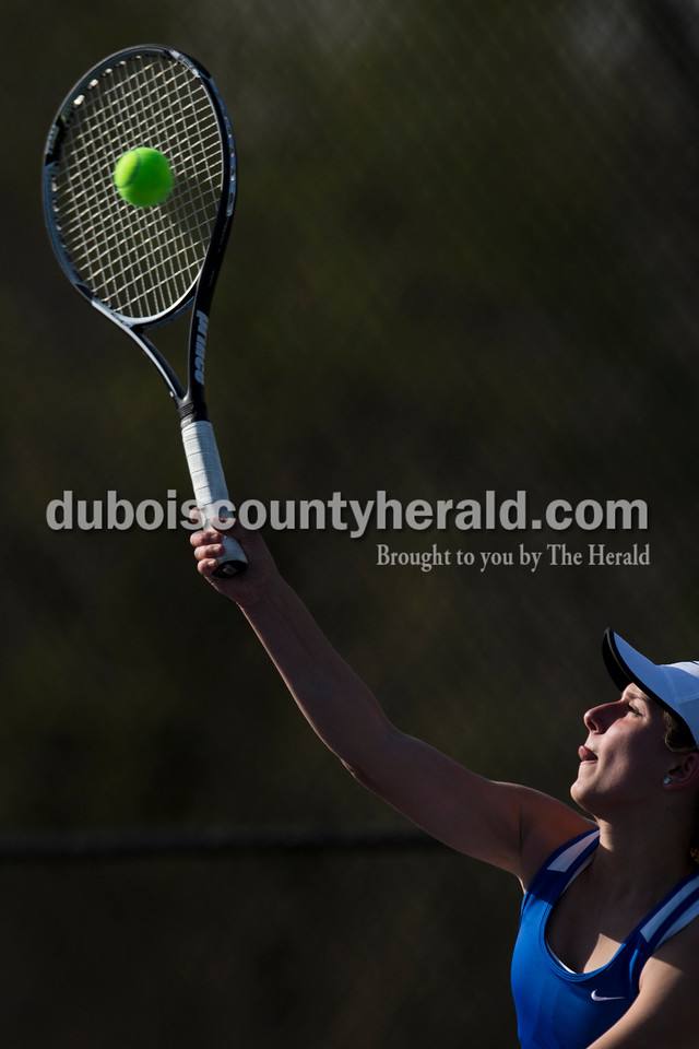 Northeast Dubois' Paige Knies served the ball during Monday's tennis match in Dubois. Southridge defeated Northeast Dubois 3-2. Sarah Ann Jump/The Herald