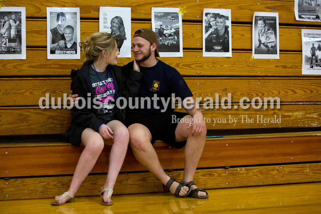 Tegan Johnston/The Herald<br /> Northeast Dubois junior Amanda Ehrhard and senior Prom King Cole Scherzinger took a break together after playing games during the school's post-prom party on Saturday evening. Juniors and seniors gathered with their guests in the high school gym to enjoy the Hollywood-themed event's variety of games and refreshments.