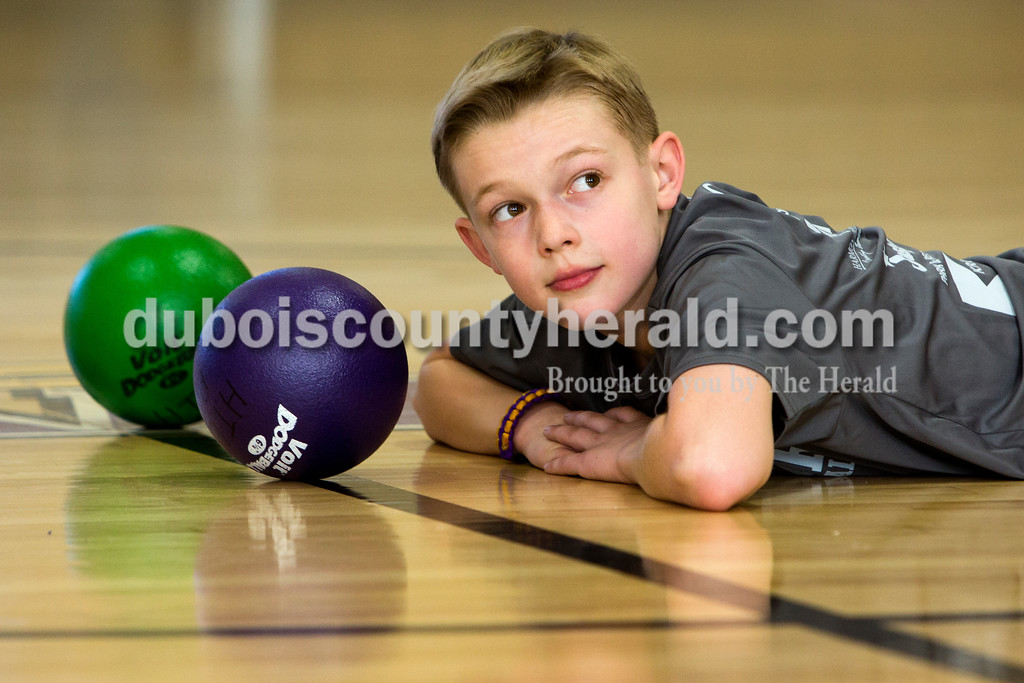 Tegan Johnston/The Herald<br /> Holy Trinity fourth-grader Eli Flick waited for the whistle to blow to start the next game of dodge ball during Holy Trinity Family Dodge Ball Night at Holy Family's East Campus Gymnasium in Jasper on Friday night. The school hopes to start having monthly dodge ball games where students can play together and get to know their classmates. From 6-7:30 p.m. second through fourth grade students can play with their parents, and from 7:30-9 p.m. fifth through eighth grade students can compete.