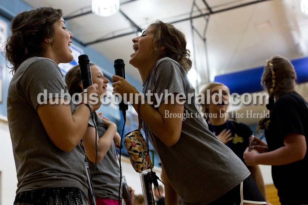 """Tegan Johnston/The Herald<br /> Northeast Dubois seniors Taylin Friedman, left, and Aubrey Marks sang """"Gotta Go My Own Way"""" from High School Musical during karaoke at the school's post-prom party on Saturday evening. Juniors and seniors gathered with their guests in the high school gym to enjoy the Hollywood-themed event's variety of games and refreshments."""