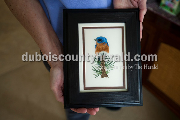 Laura Hawley of Jasper held a needlework piece of an eastern blue bird designed by Tania Berlin. This particular style of needlework is often called needle painting.   Alisha Jucevic/The Herald