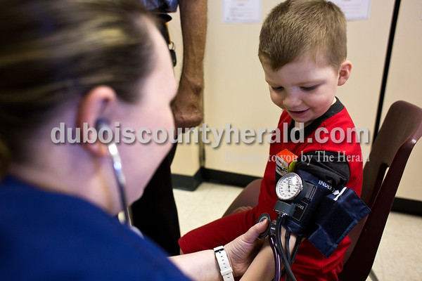Tegan Johnston / The Herald Dustin Bleemel of Jasper, 4, watched as VUJC nursing student Brandee Bird took his blood pressure during Fifth Street School's Community Health Fair on Thursday in Jasper. Thirty-six vendors set up at the school to promote healthy living with nutritious snacks and a variety of activities for families to enjoy.