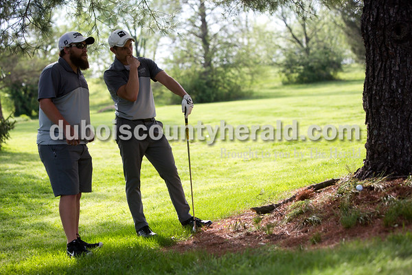 Tegan Johnston / The Herald Jasper's assistant coach Michael Bies gave Matt Lottes tips on how to get his ball away from the tree during a match against Southridge on Wednesday at Buffalo Trace Golf Course in Jasper. Jasper beat Southridge 157-180.