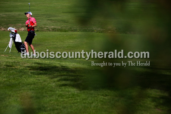 Tegan Johnston / The Herald Southridge's Drew Dearing watched for his ball to land after he swung during a match against Jasper on Wednesday at Buffalo Trace Golf Course in Jasper. Jasper beat Southridge 157-180.