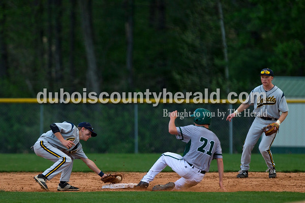 Forest Park's Daniel Lusk slid safely into second as Castle's Nathan James reached out to tag him during Tuesday night's game in Ferdinand. The Rangers lost 10-3.   Alisha Jucevic/The Herald