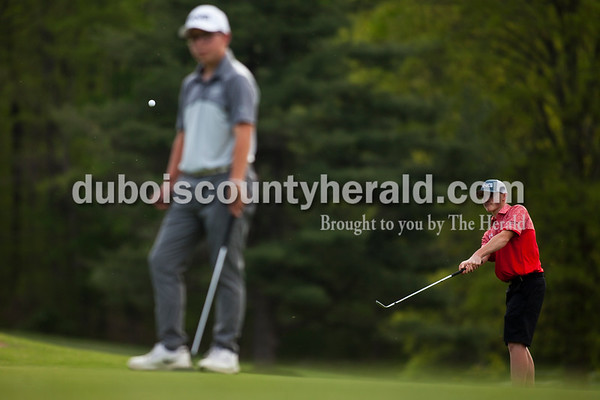 Tegan Johnston / The Herald Southridge's Coby Reller watch for his ball to land after he swung during a match against Jasper on Wednesday at Buffalo Trace Golf Course in Jasper. Jasper beat Southridge 157-180.