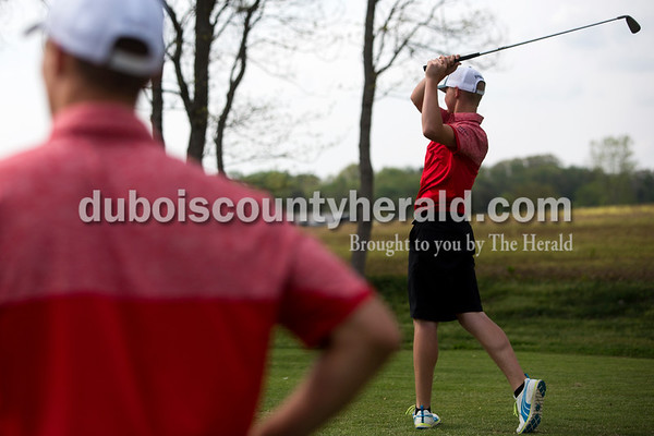 Tegan Johnston / The Herald Southridge's Drew Dearing, left, watched as his teammate Coby Reller swung to hit the ball during a match against Jasper on Wednesday at Buffalo Trace Golf Course in Jasper. Jasper beat Southridge 157-180.