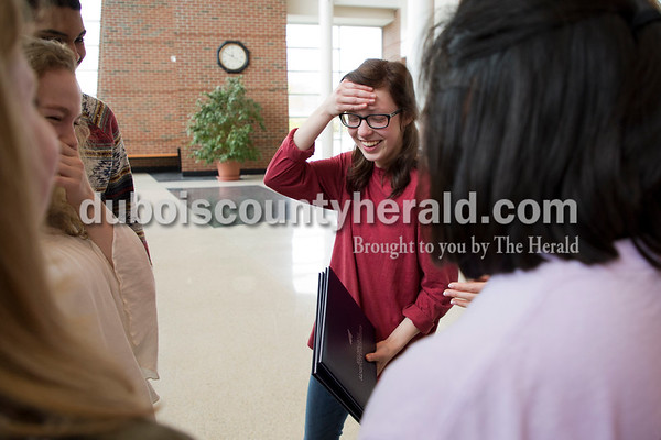 Sarah Ann Jump/The Herald Jasper High School junior Emily Huddleston was overcome with emotion as she was surrounded by classmates congratulating her on receiving two awards in a national yearbook photography contest at the school in Jasper on Tuesday.