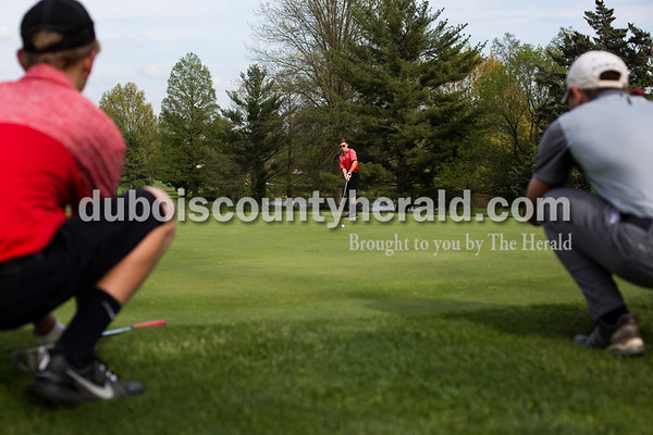 Tegan Johnston / The Herald Southridge's Tristan Boerner putted the ball as his teammate Owen Kinker and Jasper's Matt Lottes watched during a match on Wednesday at Buffalo Trace Golf Course in Jasper. Jasper beat Southridge 157-180.