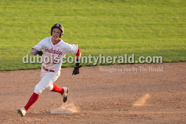 Southridge's Ross Eckert rounded second base during Wednesday's game in Huntingburg. Wood Memorial defeated Southridge 11-3. Sarah Ann Jump/The Herald