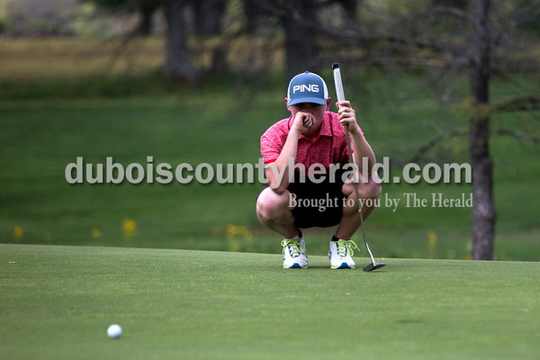 Tegan Johnston / The Herald Southridge's Coby Reller lined up his putt during a match against Jasper on Wednesday at Buffalo Trace Golf Course in Jasper. Jasper beat Southridge 157-180.