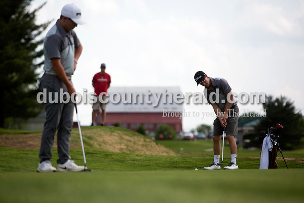 Tegan Johnston / The Herald Jasper's Jack Bies, left, watched as teammate Carson Pierce prepared to hit his ball during a match against Southridge on Wednesday at Buffalo Trace Golf Course in Jasper. Jasper beat Southridge 157-180.