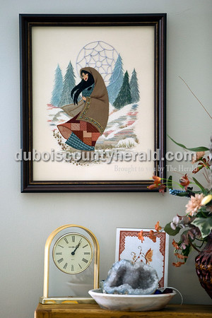 A needle point piece of Sacajawea designed by Dorothy Lesher and stitched by Laura Hawley hangs on Hawley's living room wall. Working about four to six hours a day, this piece took her a couple of months to complete.   Alisha Jucevic/The Herald
