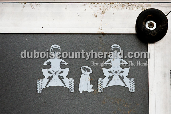 Decals featuring male and female ATV riders with their dog on Craig Englert's trailer.