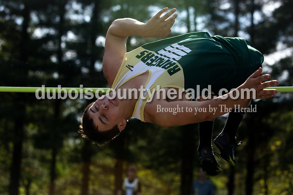 Tegan Johnston / The Herald Forest Park's Corbin Bell flung himself over the bar while competing in the high jump during the Northeast Dubois invitational on Tuesday in Dubois.
