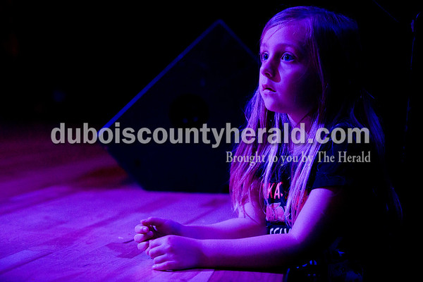 "Sarah Ann Jump/The Herald Jaidyn Stepp, 6, watched from the edge of the stage as her sister Zoe Stepp, a fourth-grader at Nancy Hanks Elementary School, participated in Tuesday's ""Lion King Jr."" play rehearsal at Heritage Hills High School in Lincoln City."