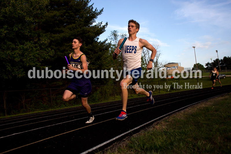 Tegan Johnston / The Herald<br /> Northeast Dubois' Jeb Knies competed in the 1600-meter relay during the Northeast Dubois invitational on Tuesday in Dubois.