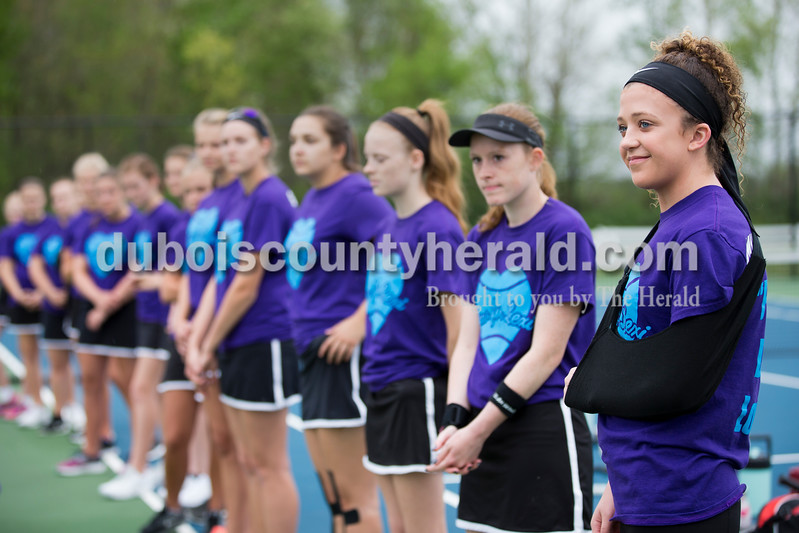 "Sarah Ann Jump/The Herald<br /> Southridge High School sophomore Lexi Mattingly of Holland, 16, right, stood with the tennis team during introductions before a tennis match at the school in Huntingburg on Monday. The team wore matching shirts that read ""Luv for Lexi""."
